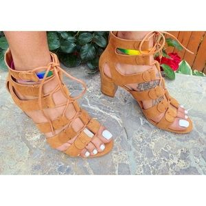Laced caged strapped heel sandal